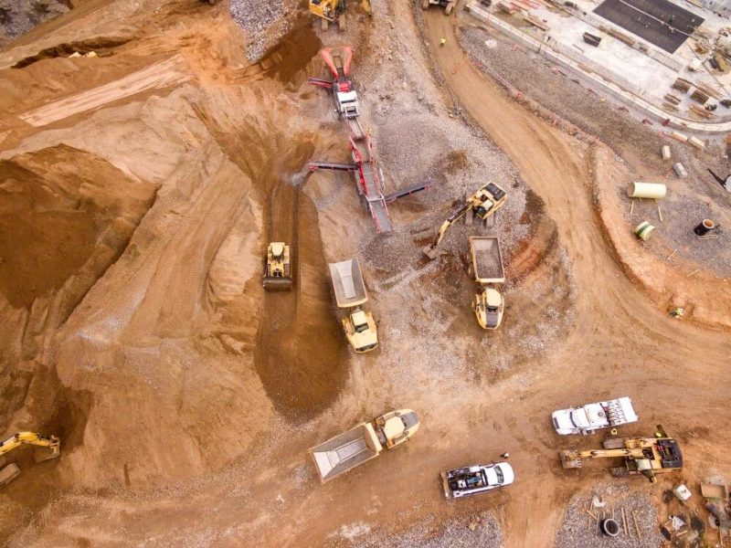 Open mine with trucks, mining industry overview